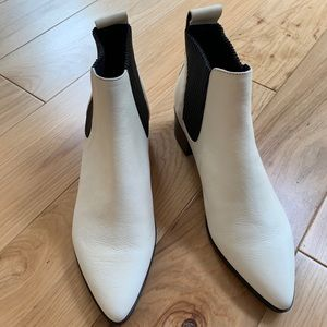 White and black boots by dolce vita.